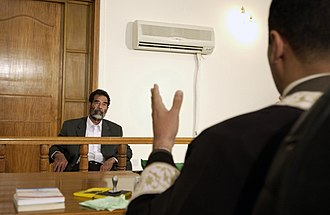 Trial of Saddam Hussein - Saddam Hussein sits before an Iraqi judge at a courthouse in Baghdad, 1 July 2004.