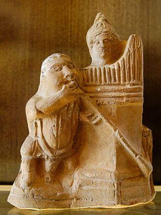 Salpinx - Musicians playing the salpinx (trumpet) and the hydraulis (water organ). Terracotta figurine made in Alexandria, 1st century BC