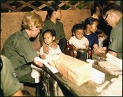 Second Lieutenant Kathleen M. Sullivan treats a Vietnamese child during Operation MED CAP, a U.S. Air Force civic... - NARA - 542331