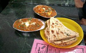 Cuisine of Uttar Pradesh - Shahi Paneer and bread.