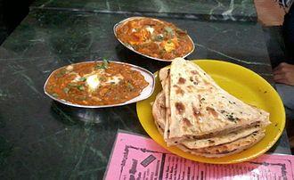 Cuisine of Uttar Pradesh - Shahi Paneer and bread.