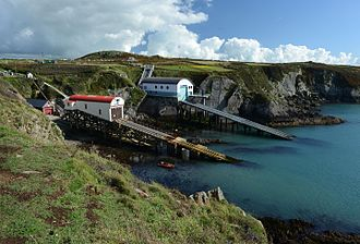 St Davids Lifeboat Station - Three boathouses shown in 2016 (newest on right)