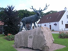 Statue of a stag outside Baxters Highland Village.
