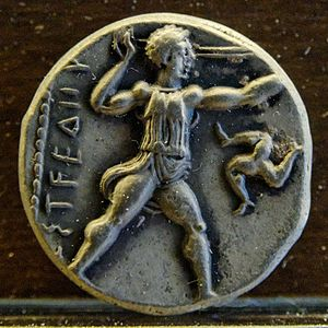 Pamphylia - Slinger standing left, triskelion to right. Reverse of a silver stater from Aspendos, Pamphylia.