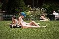 Sunbathing woman in baseball hat NYC 2008-06-29.jpg