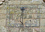 Sundial on the porch of St. Giles Church, Chesterton.jpg