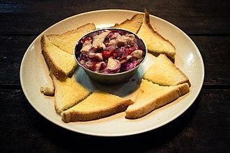 Sabahan cuisine - Swordfish hinava served with sandwich bread.