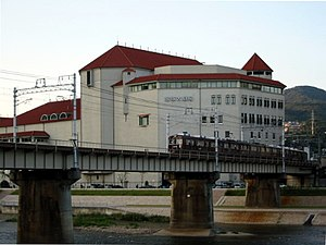 Takarazuka Grand Theater and Hankyu train.jpg