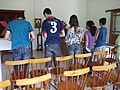 Teenagers praying the Liturgy of the Hours - Mosteiro Beneditino Santíssima Trindade.JPG