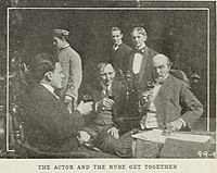 Another film still depicting the Actor and Jenkins alongside other members of the cast.