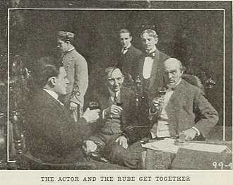 The Actor and the Rube - Another film still depicting the Actor and Jenkins alongside other members of the cast.