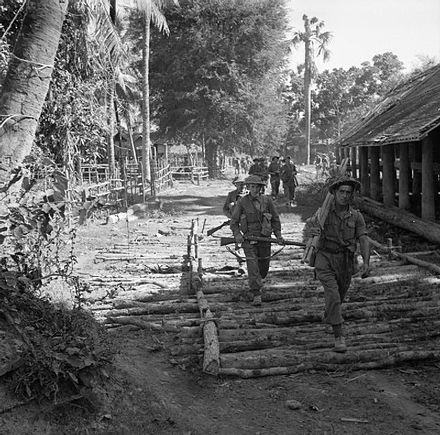 Men of the 6th Battalion, South Wales Borderers, 36th Infantry Division, march through Bahe en route for Mandalay, January 1945.