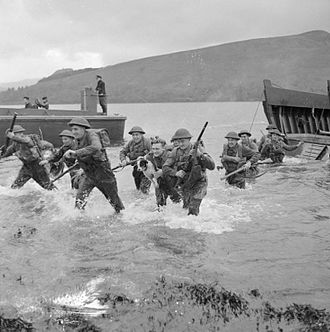Queen's Own Royal West Kent Regiment - Men of the 1st Battalion, Queen's Own Royal West Kent Regiment wade ashore from landing craft during combined operations training in Scotland, 17 November 1942.