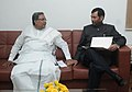 The Chief Minister of Karnataka, Shri Siddaramaiah calling on the Union Minister for Consumer Affairs, Food and Public Distribution, Shri Ram Vilas Paswan, in New Delhi on December 04, 2014.jpg