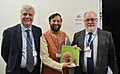 The Minister of State for Environment, Forest and Climate Change (Independent Charge), Shri Prakash Javadekar presenting the book on Climate Change authored by the Prime Minister, Shri Narendra Modi to the EU Commissioner.jpg