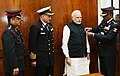 The Officers of the Kendriya Sainik Board pinning a flag on the Prime Minister, Shri Narendra Modi, on the occasion of the Armed Forces Flag Day, in New Delhi on December 07, 2016.jpg