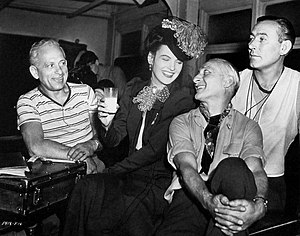 Paul Ivano - Ivano (right) with camera assistants Robert Lazlo and Frank Heisler and Ella Raines on the set of The Suspect (1944)