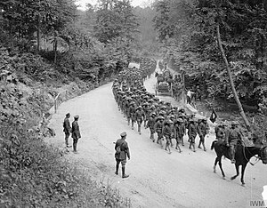 77th Sustainment Brigade - Men of the 307th Infantry Regiment (attached to the British 42nd Division for instruction), headed by a British regimental band, marching past Major-General Arthur Solly-Flood (42nd Division) on a road near Famechon, France, 7 June 1918.