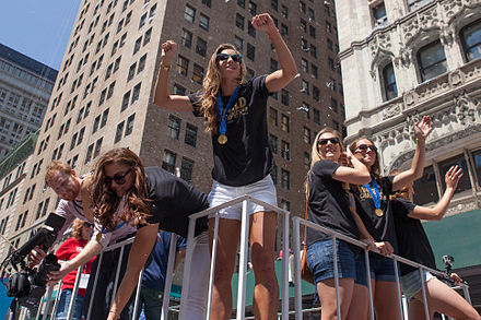 Heath (center) celebrating the 2015 FIFA Women's World Cup win at the ticker-tape victory parade in New York City, July 2015 The United States Women's Soccer Team Ticker-Tape Parade New York City (18962536224).jpg