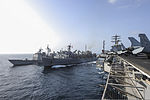 The guided missile cruiser USS Princeton (CG 59), far left, and the aircraft carrier USS Nimitz (CVN 68), right, conduct a replenishment at sea with the fast combat support ship USNS Rainier (T-AOE 7) June 22 130622-N-ZG290-106.jpg