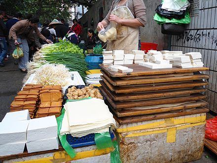 Several kinds of soybean products are sold in a farmer's market in Haikou, China.