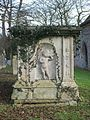 Tomb with weeping putto, Holywell, Cambs.JPG
