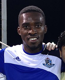 Tomi Ameobi with fans after a FC Edmonton game 2014-05-08 15-16 (cropped).jpg