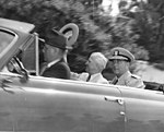 Truman Seated In Car Waving His Hat Along With Admiral Radford In Hawaii.jpg