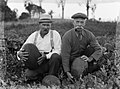 Two farmers with watermelons in field (AM 79520-1).jpg