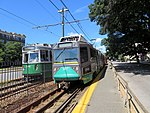 Two trains at Allston Street station, August 2018.JPG