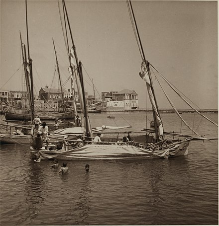 """Unloading Melons"" - photographed in 1938 by John David Whiting from the American Colony (Jerusalem) TyreSourLebanon-Harbour1938-JohnDavidWhiting-GEricMatson LoC-17416-00030.jpg"