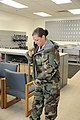 U.S. Air Force Senior Master Sgt. Kimberly Guidry, with the Air Force Personnel Center, tries on a chemical warfare suit to prepare for a pending deployment at the readiness center at Randolph Air Force Base 110802-F-ZE476-112.jpg