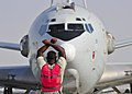 U.S. Air Force Staff Sgt. Clifford Scott, an E-3 Sentry aircraft computers technician with the Sentry Aircraft Maintenance Unit, 380th Expeditionary Aircraft Maintenance Squadron, marshals an E-3 at an 140312-F-XR500-037.jpg