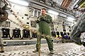 U.S. Air Force Tech. Sgt. Tony Perry, with the Hawaii Air National Guard, secures a vehicle to the cargo bay of a C-17 Globemaster III aircraft during exercise Makani Pahili at Joint Base Pearl Harbor-Hickam 130601-Z-UW413-112.jpg