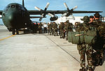 U.S. Air Force security policemen board a C-130E Hercules aircraft during Exercise Volant Scorpion '85 DF-ST-86-10385.jpg