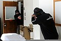 U.S. Army Sgt. 1st Class Jay Brown, left, enters a room where Center Grove, Ind., police chief Kortney Burello role plays as a gunman during the Indiana Department of Education Active Shooter training Nov. 10 111110-A-YX241-004.jpg
