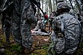 U.S. Army Sgt. Dayna Taylor, a licensed practical nurse with Alpha Company, Madigan Army Medical Center, demonstrates assessing a causality during Expert Field Medical Badge training at Joint Base Lewis-McChord 130404-A-FS521-110.jpg