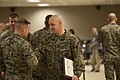 U.S. Marine Corps Gunnery Sgt. Aubrey T. Wrenn, Combat Instructor, Infantry Training Battalion, School of Infantry-East (SOI-E), shakes hands with Sgt. Maj. Christopher J. Garza, Battalion Sgt. Maj 131220-M-AX605-225.jpg