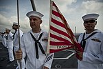 U.S. Navy Aviation Boatswain's Mates (Handling) 1st Class Anthony Taylor, left, and Jesus Cubol prepare to raise the union jack on the flight deck aboard the aircraft carrier USS George Washington (CVN 73) 130823-N-BD107-110.jpg