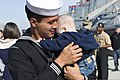U.S. Navy Damage Controlman 3rd Class Ron Monteroso holds his son during a homecoming for the guided missile destroyer USS Stout (DDG 55) at Naval Station Norfolk, Va., April 4, 2014 140404-N-KD168-114.jpg