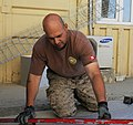 U.S. Navy Utilitiesman 1st Class Teodor Medina, with Naval Mobile Construction Battalion 15, prepares duct work for a project supporting Combined Special Operations Task Force 10 at Camp Phoenix in Kabul 130527-A-CV700-007.jpg