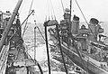 USS Chicopee (AO-34) refueling a Fletcher-class destroyer, circa in 1943.jpg