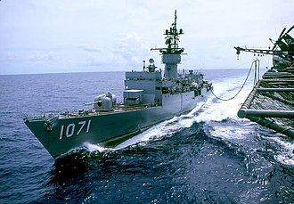 USS Badger (FF-1071) - Badger being refueled by the carrier Midway in the South China Sea in 1975.