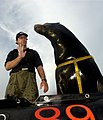 US Navy 030212-N-3783H-008 A Sea Lion trainer from Space and Naval Warfare Systems Center (SPAWAR), San Diego, works on hand signal commands with Zak, a 375-pound California sea lion.jpg