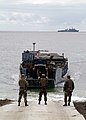 US Navy 030310-N-0401E-002 A Landing Craft Utility (LCU), is guided ashore by Sailors from Beach Master Unit One (BMU-1) as it transports U.S. Marines and their equipment ashore from the Essex Amphibious Ready Group (ARG).jpg