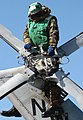 US Navy 040505-N-5549O-044 Aviation Machinist's Mate Delone Campbell of Summerville, S.C., performs maintenance on the tail rotor of an SH-60F Seahawk.jpg