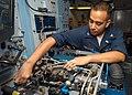US Navy 041019-N-6651N-001 Aviation Electrician Technician 3rd Class Robert Maregian of Detroit, Mich., assembles an S-3 Viking APS-137 transmitter.jpg