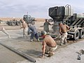 US Navy 041119-N-5386H-027 Reserve Seabees assigned to Naval Mobile Construction Battalion Two Three (NMCB-23), pour concrete as they work to complete an extensive repair job.jpg