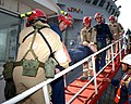 US Navy 050228-N-9563N-003 Members of Naval Support Activity (NSA) Bahrain's Emergency Response Team (ERT) carries a simulated casualty to a designated medical area from the mine countermeasure ship USS Cardinal (MHC 60) during.jpg