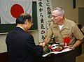 US Navy 050603-M-9881Y-003 U.S. Navy Chaplain, Lt. G. Alan Fleming accepts an award from the President of the Nippon Zenkokais.jpg